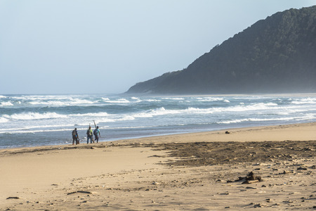 Beach of St. Lucia with fishermen, South Africa