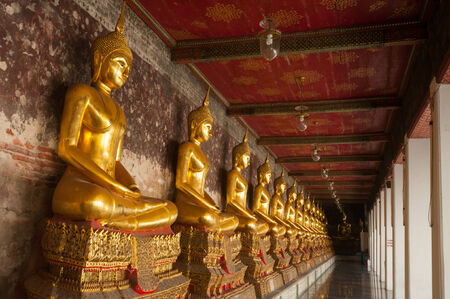 Buddha image in the gallery of the temple photo