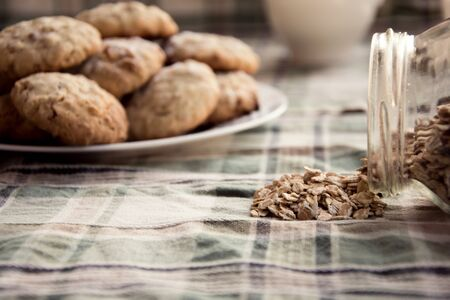 glass jar: Glass jar with oat on tablecloth. Close-up Stock Photo