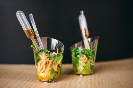 Two mini salad with sauce. Selective focus. Stock Photo