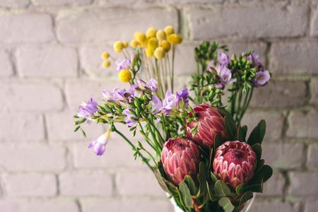 Craspedia, freesia and protea flowers. Flower market