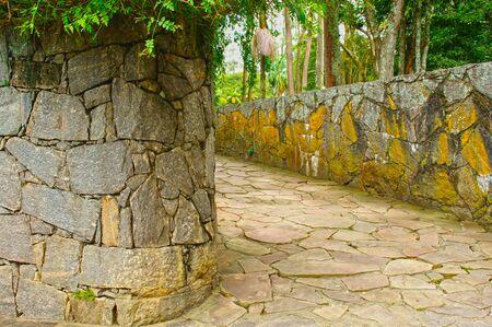 Building vintage stone way crossing park