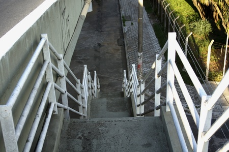 Staircase building join at to viaduct to passed people photo