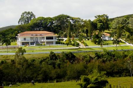 A modern house, newly built, shot against a blue sky
