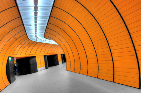 orange interior of an industrial hall with black doors Editorial