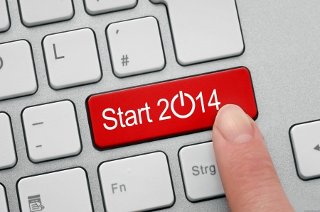 Red button to start the new year of 2014 on computer