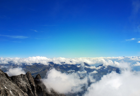 Vast view of mountain peaks above clouds