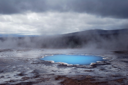 Iceland Krafla geothermal pool with blue steamy surface Stock Photo