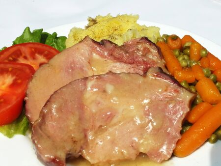 German pork roast with potatoes and vegetables Stock Photo - 13792776