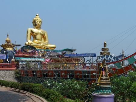 mekong: Golden Buddha on the Mekong  Stock Photo