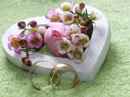 wedding rings  heart  with delicate blossoms in small stones photo
