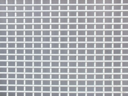 grating of metal against a gray background