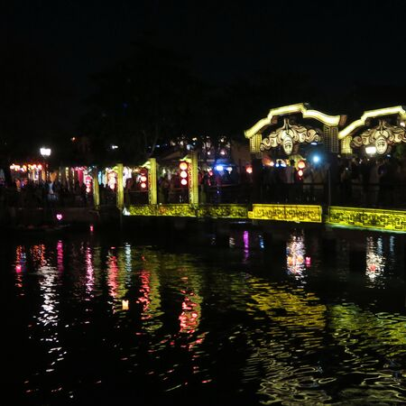 """in the evening in """"hoi an"""" the city of tailors and lampions beautiful old town with river boats and many flowers at the houses, with without many tourists central vietnam march 2019"""