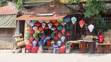 """in the morning in """"hoi an"""" the city of tailors and lampions beautiful old town with river boats and many flowers at the houses, only in the morning without many tourists central vietnam march 2019"""