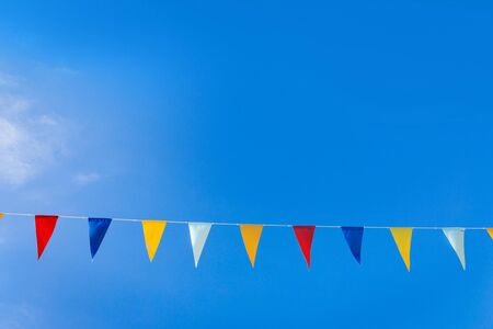 pendent: triangle flags on blue sky