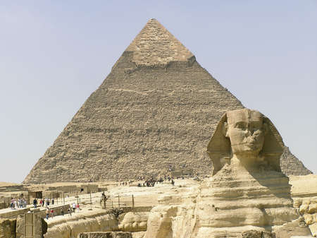 Tourists vising Sphinx of Giza (Giseh), the Khephren pyramid  in the background