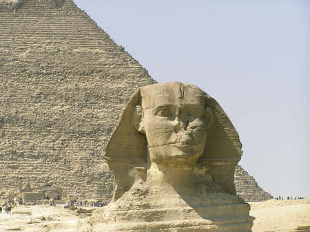 close-up of the Sphinx of Giza (Giseh) and Khephren pyramid in the background ,Egypt, Africa Stock Photo