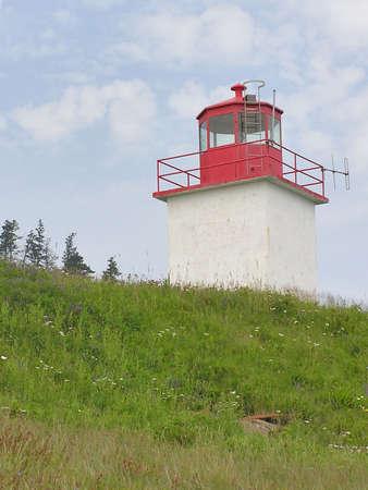 Old Red Lighthouse on Nova Scotia coastline, Canada photo