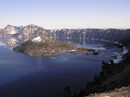 classify: Crater Lake widely known for its intense blue color and spectacular views. Classify as the most limpid lake around the world.- National Park, Oregon