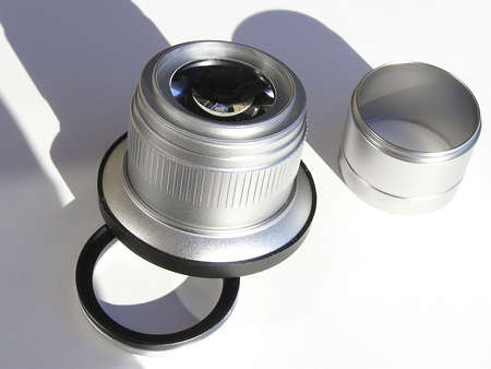 Macro, wide angle lens and adaptor for camera on a white background photo