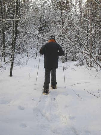 Active senior in snowshoes, Quebec, Canada Stock Photo