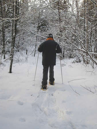 snowshoes: Active senior in snowshoes, Quebec, Canada Stock Photo