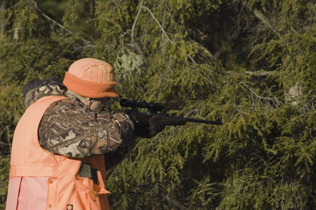 The hunter aiming a deer in his sight, Quebec, Canada Stock Photo