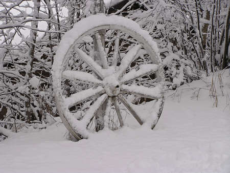 abandonment: Abandoned wagon wheel in the snow, Quebec, Canada
