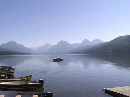 macdonald: The peaceful MacDonald lake in the mist on early morning  in West Glacier national Park, Montana, USA