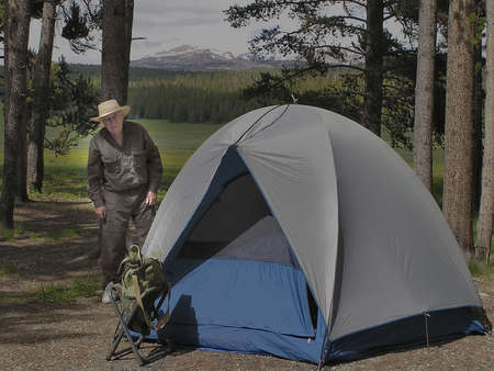 Senior man camping in Devil Tower National Park, USA Stock Photo