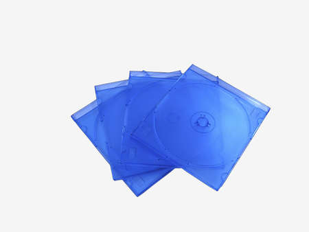 Plastic blue thin cases for compact discs isolated on a white background
