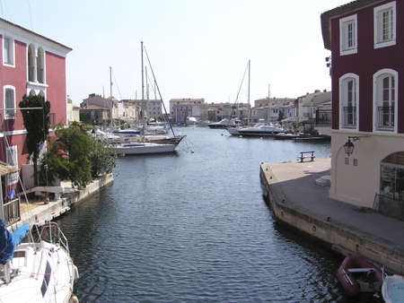 Canal of Port Grimaud, 12 km of piers lined with cafes and  villas with fishing  boats anchored, Saint Tropez Gulf, Cote dAzur, France.Also called Venice of the French Riviera. Stock Photo