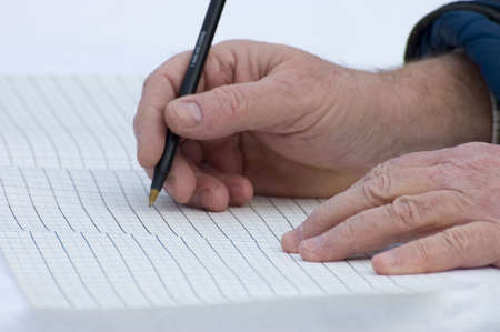 close up of old hands writing data Stock Photo