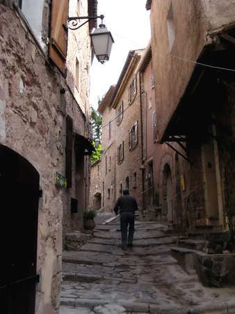 old French worker  in a street of  Les Arcs sur Argens, Provence, France -  medieval hamlet