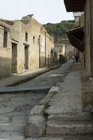 Street of Herculanum with houses and detail of Herculaneum Excavations. Ruins from the vulcano eruption, Naples, Italy
