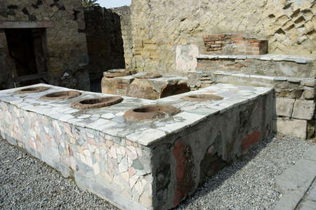Herculanum Thermopolium or fast foods restaurant,  ruins from the vulcano eruption in Herculanum or Ercolano, Naples, Italy,  In the Antiquity, the thermopolium had the same use than a fast foods restaurant.