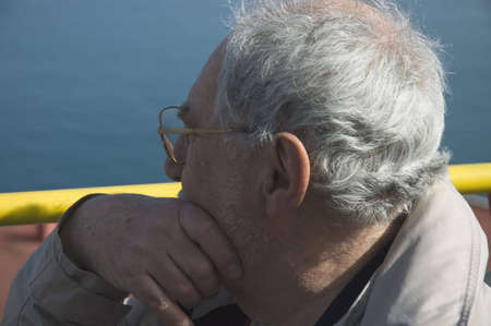 Close up of an elderly tourist in a bus tour with the blue sky of Naples in the background Elderly tourist in Naples