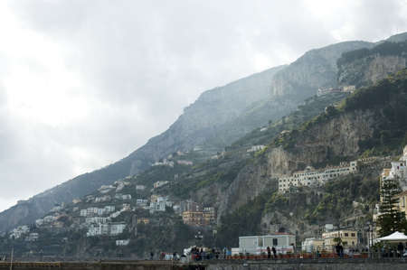 view of the famous town of Amalfi  behind the clouds seen from the beach, Sorrentine Peninsula of Italy, Stock Photo - 419107