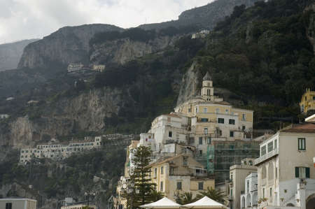 close view of the famous town of Amalfi  behind the clouds seen from the beach, Sorrentine Peninsula of Italy, Stock Photo - 419105