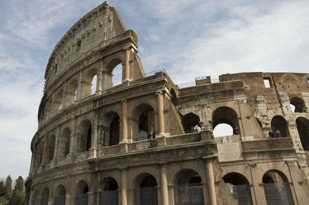 close view of the Colosseum or Flavian Amphitheater , the first permanent amphitheater to be built in Rome, Italy photo
