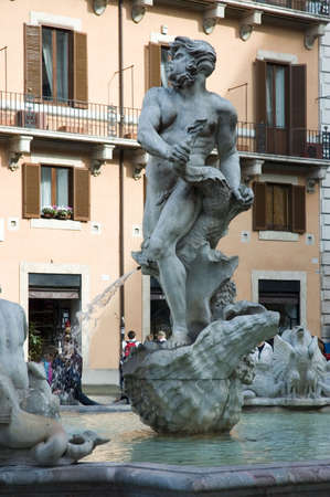 Moor Fountain, located in Piazza Navona, represents an Ethiopian fighting with a dolphin.Rome, Italy Reklamní fotografie