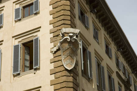 house coat: Italian coat of arms on an house in Florence,