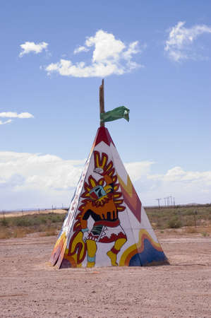 plains indian: Colored tipi or teepee with designs in the fields of  Arizona, USA Stock Photo
