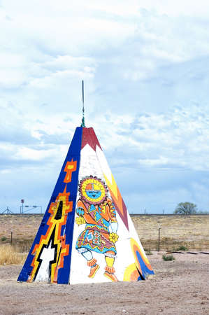 plains indian: Colored tipi or teepee with designs in the fields of Arizona, USA, specimen of the contrasting American lifestyle
