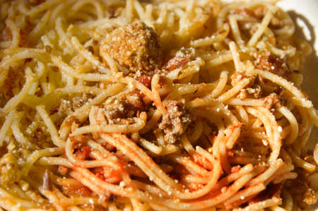 sphaghetti  with bolognese sauce and meat balls, focus on the middle