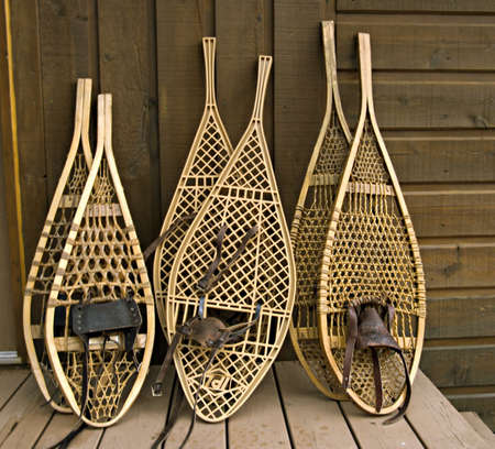 Traditional Canadian snowshoes, focus on the left pair