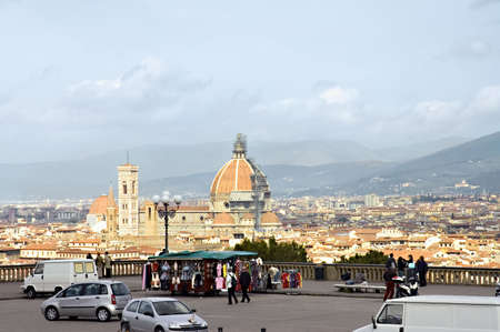 Scenic view of Florence city from piazza Michelangelo, Florence, Tuscany, Italy. View on the Duomo,the Cathedral,  the colored houses and mountains on the background.  photo