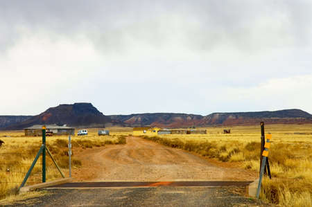 farms land decay with golden fields and reddish buttes in Morenci mining area, Arizona, USA photo