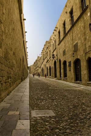 rhodes: Perspective view of the Avenue of the Knights, a cobblestone street in Rhodes Citadel , Greece Stock Photo