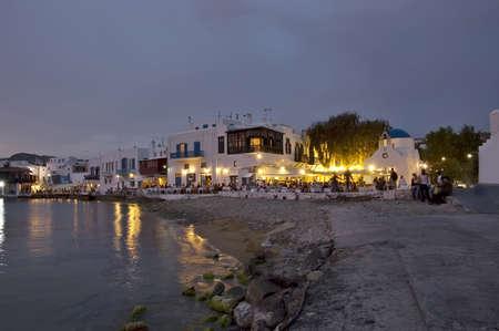 aegean: People at restaurants on the beautiful beach of Mykonos, Greece  Stock Photo